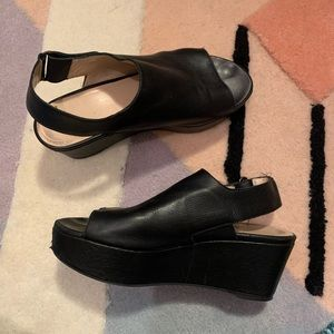 Stuart Weitzman black platform sandals.